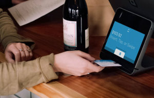 Person Inserting Credit Card at POS